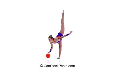 Gymnast in a nice suit is spinning a ball on his finger. White background. Slow motion