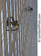 Window Washers - Window washers on a highrise office...