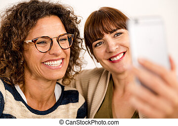 Best friends making a selfie - Two beautiful firends at home...