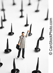 Risky business - Businessman figurines standing on springs...
