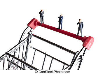 figurines on a shopping cart - Businessman figurines on a...