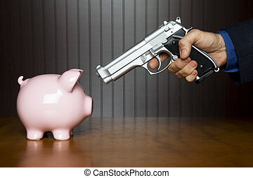 Piggy bank robbery - Man pointing a gun at a piggy bank