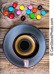 Candys and espresso on wood. Studio Photo