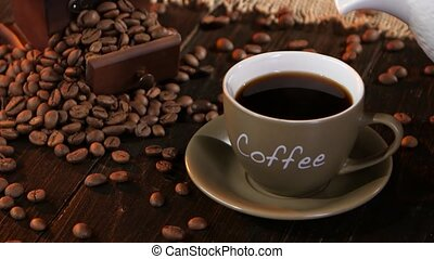 Make latte in small cup which is filled black coffee, fresh...