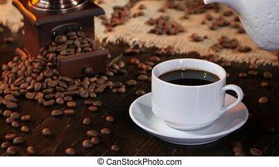 In cup of black espresso poured fresh milk or cream, small...