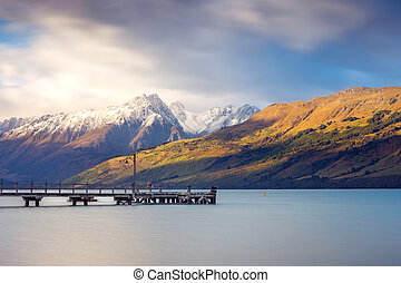 Landscape view of Glenorchy wharf, lake and moutains, New...