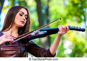 Music street performers with girl violinist - woman violin...