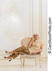 Elegant mature lady keeping tobacco pipe - Relaxed old woman...