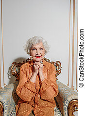 Senior lady in anticipation of good news - Cheerful old...