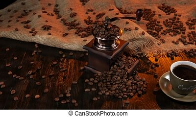 Cup black hot coffee and beans scattered on the table,...