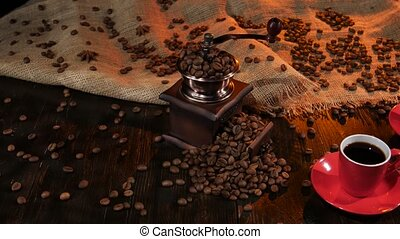 Two red cups with black coffee on the wooden table - Two red...