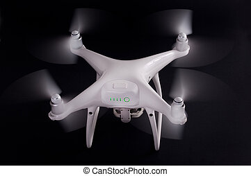 White drone against black background - White drone with...