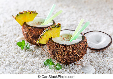 Delicious pinacolada in coconut with pineapple and mint...