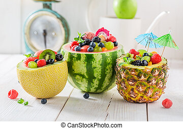 Delicious fruits salad in watermelon, pineapple and melon