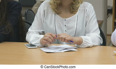 Business woman writes in notepad at the conference