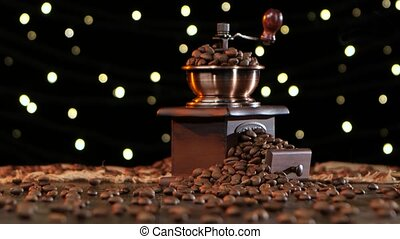 Coffee grinder with grains and cup hot drink with smoke, cup...