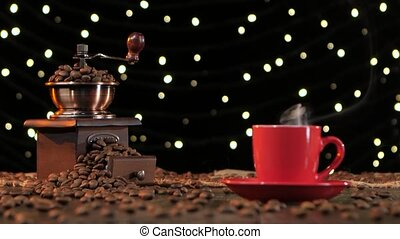 Background with lights. Coffee grinder filled with roasted...