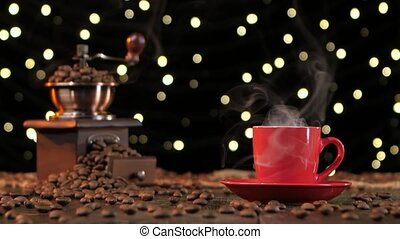 Red cup of hot coffee with smoke. Background with lights -...