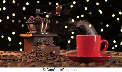 Coffee grinder filled with roasted coffee beans. Background...