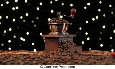 Coffee mill and red cup on saucer with hot drink, in the...