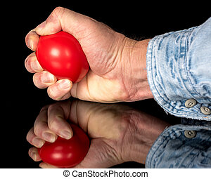 Demonstrating squeezing a red stress ball