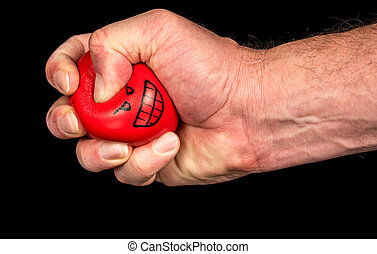 Stress ball is squeezed with a funny face
