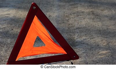 Red warning triangle with a broken down car - Transportation...