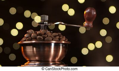 Coffee mill filled with roasted coffee beans. Closeup. Studio