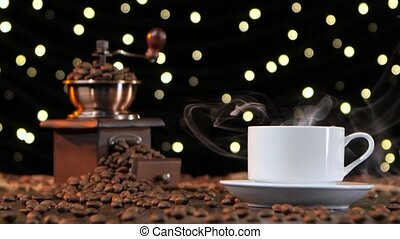 White cup with a hot drink. Black background with lights -...