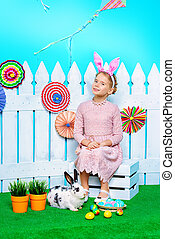 dreams and fantasy - Cute happy little girl sitting with...