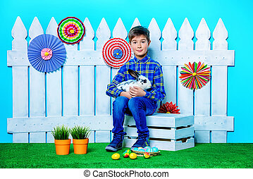 imagine fairy tale - Happy child boy with Easter Bunny and...