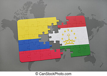 puzzle with the national flag of colombia and tajikistan on...