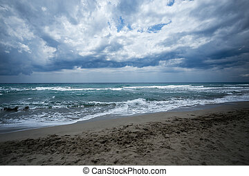 sand beach with turquiose sea and clouds - Sea view of...
