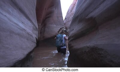 Backpacker Girl in Zebra Slot Canyon Escalante Utah -...