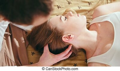 Thai massage treatment for head and hair - white young...