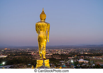 behind Buddha statue before sunset time at Wat Phra That Kao Noi Nan, Thailand