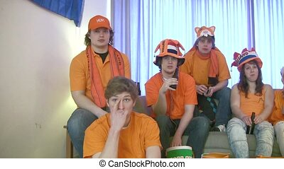 sports fans - Tense faces of sports fans, watching a game on...