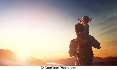 Father and baby at sunset