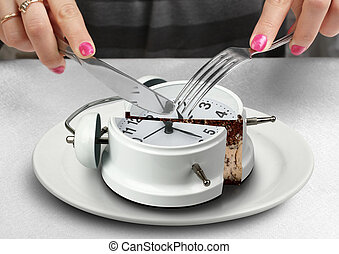 lunchtime concept, hand cut clock on plate - lunchtime...