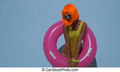 Woman in yellow swimsuit and orange wig - Happy sexy...