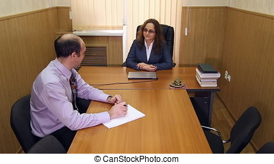 Meeting in the office of the director