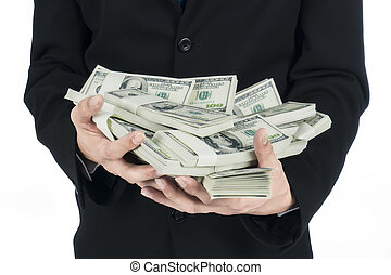 Closeup of businessman holding a lot of US Dollars in his...