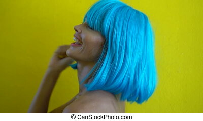 Woman in blue bikini and wig - Side view closeup portrait of...