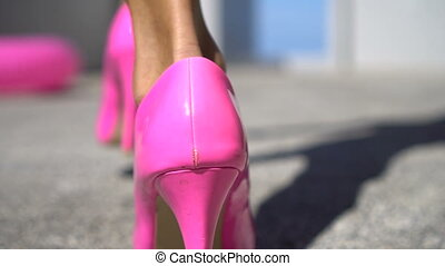 Pink high heel shoes - Closeup back view of female legs...