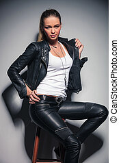 seated sexy woman in leather clothes