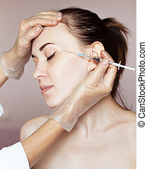 Young woman receiving cosmetic injection - Beautiful woman...
