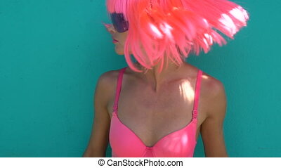 Woman in pink bra and wig