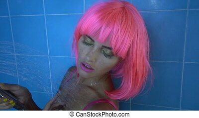 Woman in pink lingerie and wig - Sexy beautiful woman with...