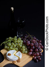 Red wine with grapes and che