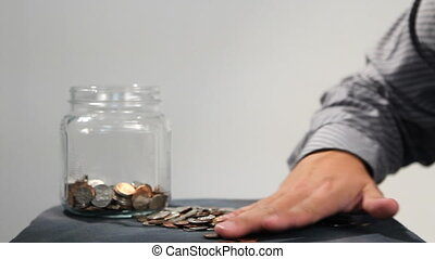 Counting Coins - Close up of mans hand as he counts...